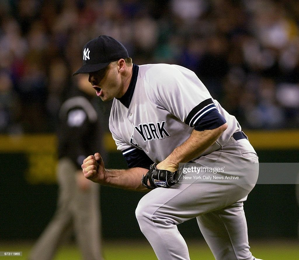 New York Yankees' Roger Clemens pumps his fist after pitching his way out of a jam in the seventh inning of Game 4 of the American League Championship Series at Safeco Field. The Rocket threw 15 strikeouts for a one-hit, complete game shutout over the Seattle Mariners as the Yanks won, 5-0 to take a 3-1 lead in the best of seven series.