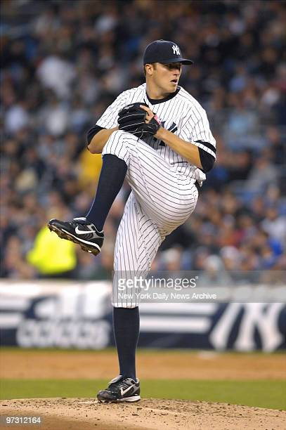 New York Yankees' rookie pitcher Phil Hughes goes through his windup during the first inning of a game against the Toronto Blue Jays at Yankee...