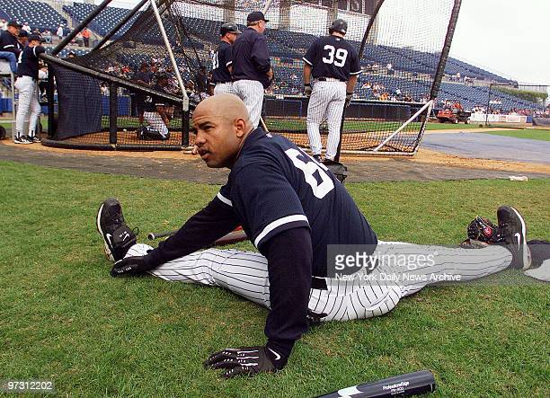 New York Yankees' Ruben Rivera stretches by the batting cage during spring training camp at Legends Field