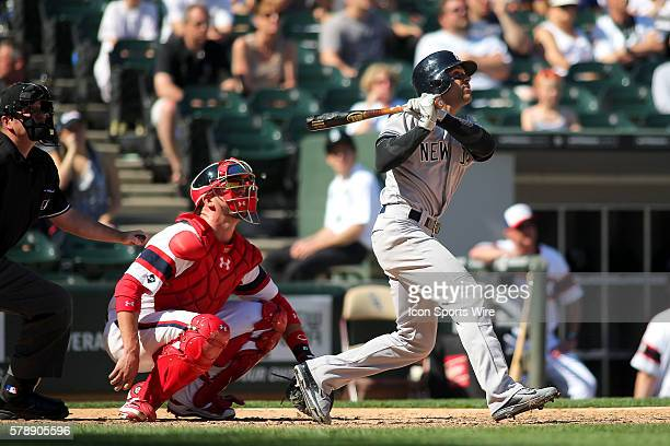 New York Yankees second baseman Brian Roberts hits a homerun in the 8th ininning in action during a game between the Chicago White Sox and the New...