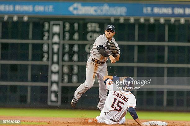 New York Yankees second baseman Brian Roberts leaps over Houston Astros catcher Jason Castro to avoid a collision turning a double play during the...