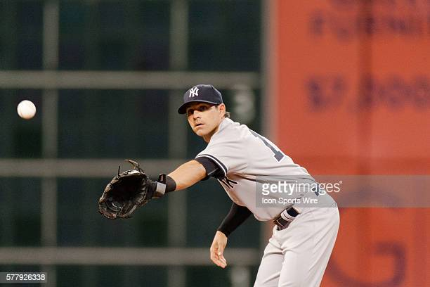 New York Yankees second baseman Brian Roberts making a catch from New York Yankees first baseman Mark Teixeira during the game against the Houston...