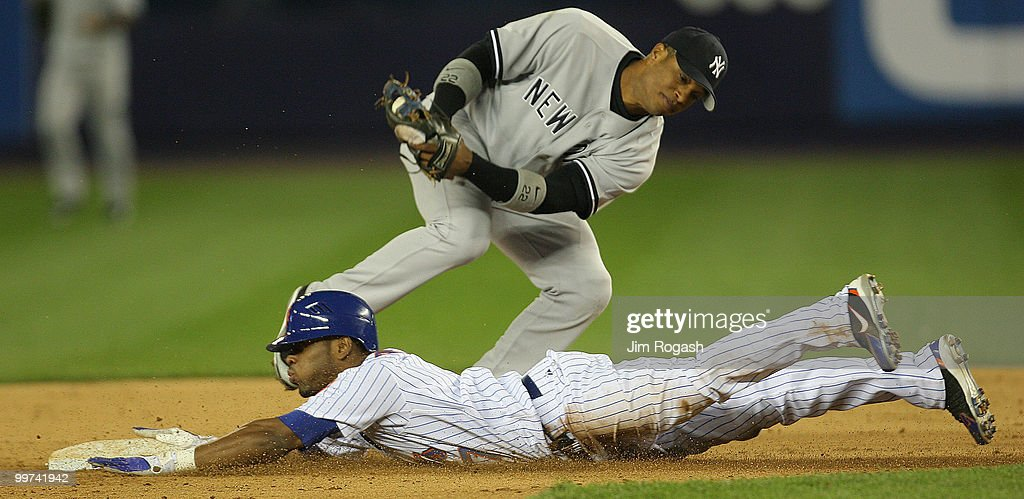 New York Yankees second baseman Robinson Cairo is late with the tag on Jose Reyes of the New York Mets at Shea Stadium, Sunday, May 22, 2006, in Flushing, New York. The Mets won 4-3.