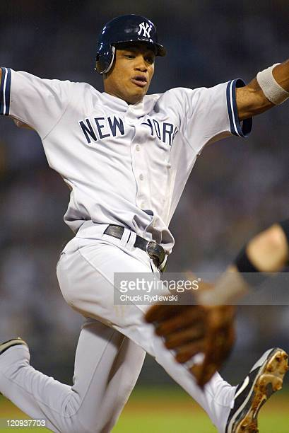 New York Yankees' second baseman, Robinson Cano, slides safely into third base during the game against the Chicago White Sox on August 19, 2005 at...