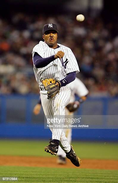 New York Yankees' second baseman Tony Womack throws to first for the putout during a game against the Tampa Bay Devil Rays at Yankee Stadium The Rays...