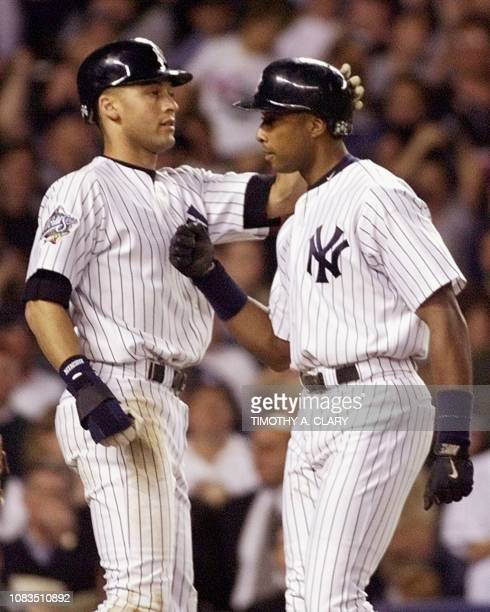 New York Yankees shortstop Derek Jeter congratulates teammate Bernie Williams after Williams hit a tworun home run in the second inning of game two...