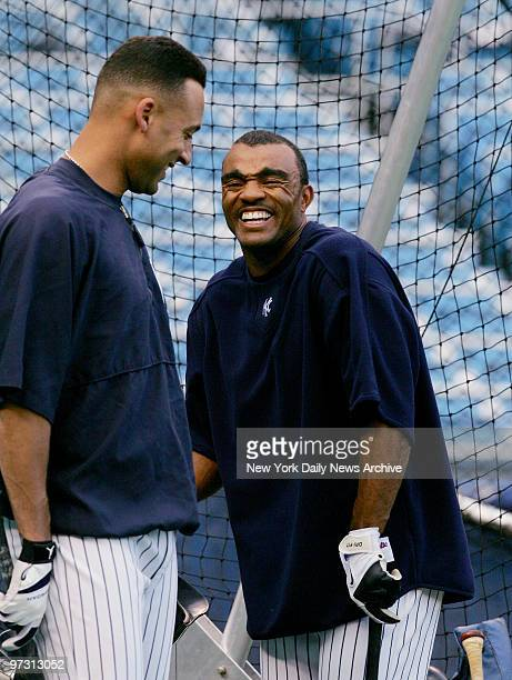 New York Yankees' shortstop Derek Jeter jokes with infielder Tony Womack during batting practice before Game 3 of a threegame series against the...