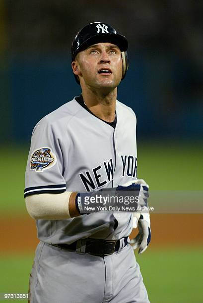 New York Yankees' shortstop Derek Jeter leaves the field after being thrown out at second in a third inning double play in Game 5 of the World Series...