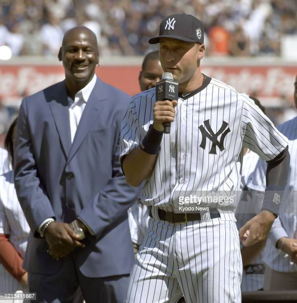 New York Yankees shortstop Derek Jeter makes a speech at his retirement ceremony at Yankee Stadium in New York on Sept 7 with basketball legend...