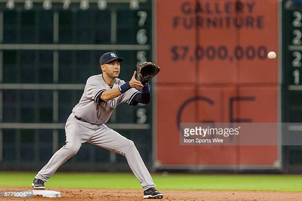 New York Yankees shortstop Derek Jeter making a catch from Brian Roberts to turn a double play during the baseball game New York Yankees defeated the...