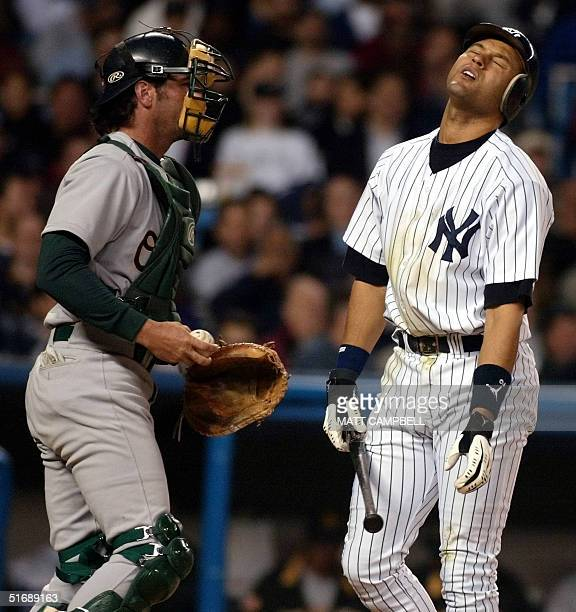 New York Yankees' shortstop Derek Jeter reacts after being called out on a third strike to end the third inning as Oakland Athletics catcher Greg...