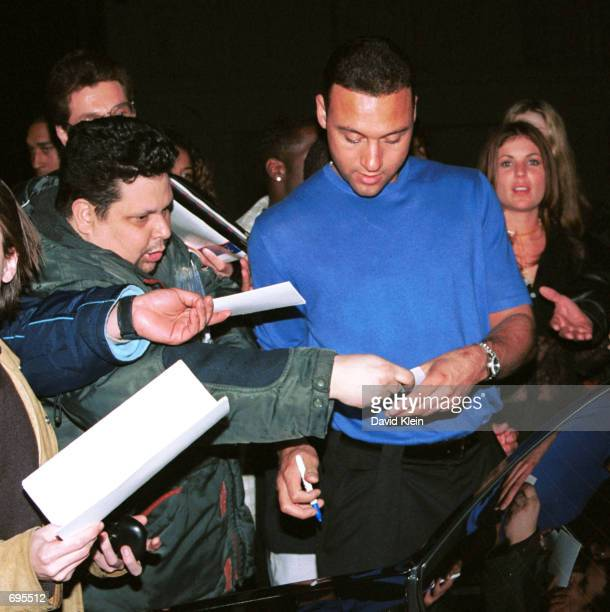 New York Yankees shortstop Derek Jeter signs autographs for fans outside Club AD January 27 2002 in Hollywood CA Photo by David Klein/Getty Images