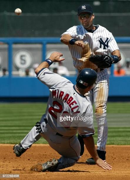 New York Yankees' shortstop Derek Jeter turns a double play as Boston Red Sox catcher Doug Mirabelli slides in too late in the fourth second inning...