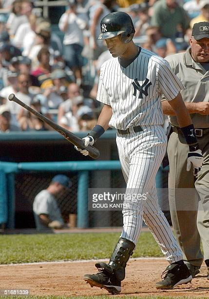 New York Yankees shortstop Derek Jeter walks back the dugout after striking out in the fifth inning against the Texas Rangers 25 August 2002 in New...