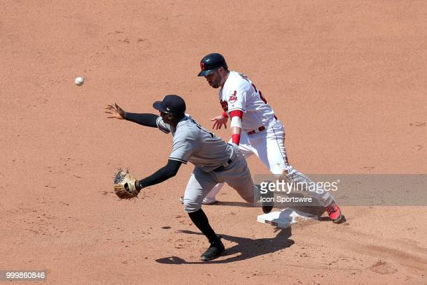 New York Yankees shortstop Didi Gregorius looses the baseball after forcing out Cleveland Indians second baseman Jason Kipnis at second base during...