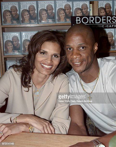 New York Yankees' slugger Darryl Strawberry and his wife Charisse are on hand at Borders Books Music in the World Trade Center to autograph their...