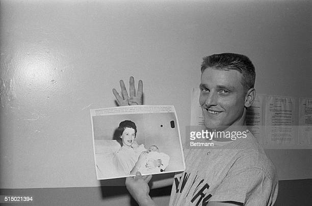 New York Yankees slugger Roger maris locks at UPI telephoto of his wife Patricia and their new son. The baby was born in Kansas City 8/21. Maris is...