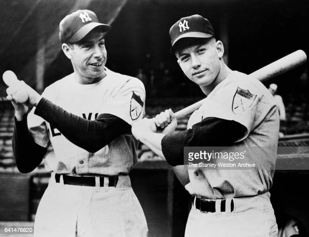 New York Yankee sluggers Joe DiMaggio and Mickey Mantle with their pine bats poising for the camera circa 1951