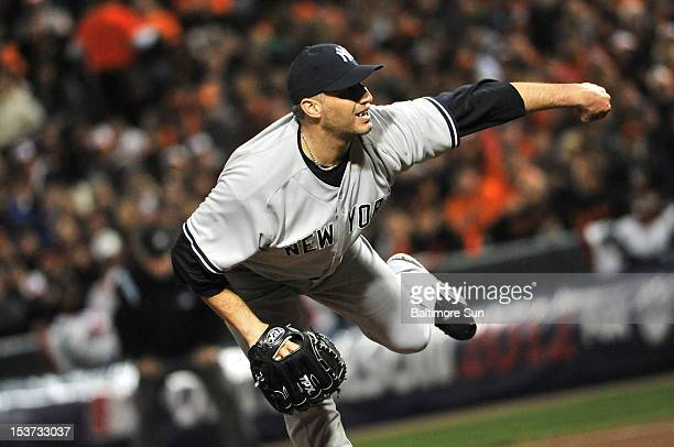 New York Yankees starter Andy Pettite pitches against the Baltimore Sun during Game 2 of the American League Division Series at Oriole Park at Camden...
