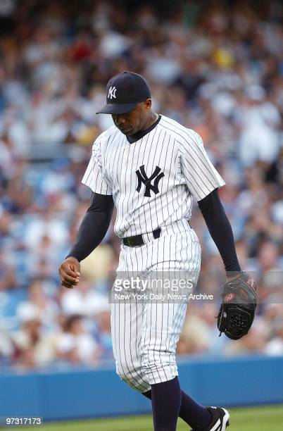 New York Yankees' starter Orlando Hernandez leaves the game complaining of numbness in his left leg after pitching a scoreless first inning against...