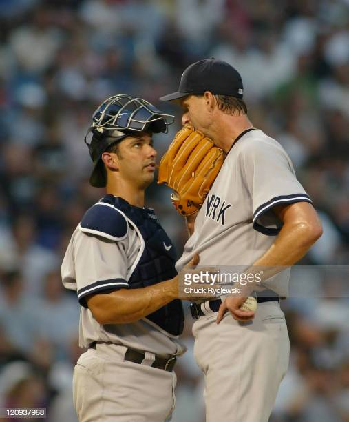 New York Yankees' Starter, Randy Johnson, confers with his catcher, Jorge Posada, during the game against the Chicago White Sox August 9, 2006 at...