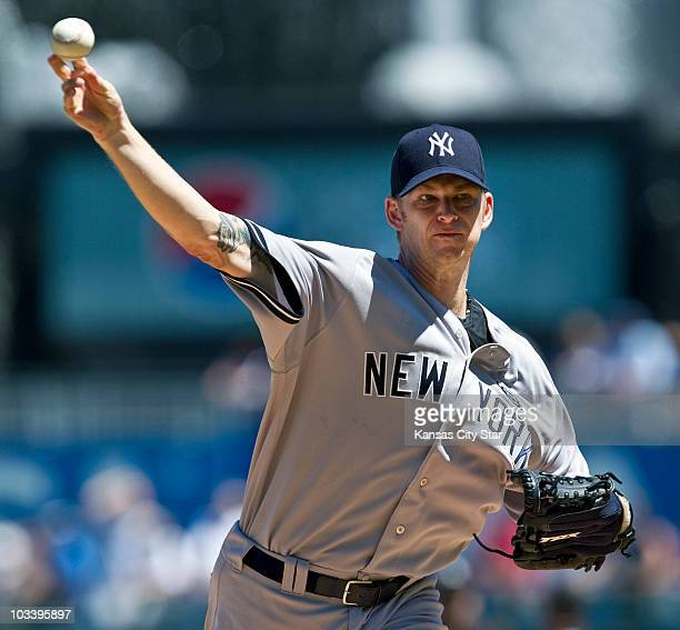 New York Yankees starting pitcher AJ Burnett throws in the first inning against the Kansas City Royals during a baseball game at Kauffman Stadium in...