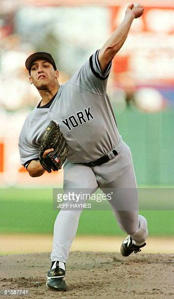 New York Yankees starting pitcher Andy Pettitte delivers a pitch in the first inning of the Yankees 64 win against the Baltimore Orioles in the...