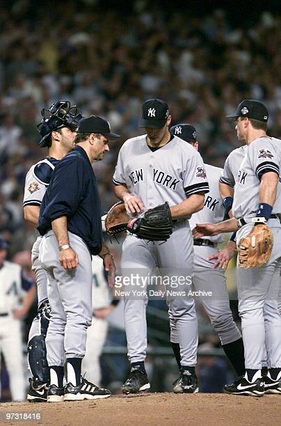 New York Yankees' starting pitcher Andy Pettitte hangs his head as he is removed from the game by manager Joe Torre in the third inning of Game 6 of...