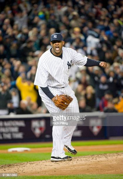 New York Yankees starting pitcher CC Sabathia pumps his fist in reaction to striking out Mike Napoli of the Los Angeles Angels of Anaheim in the top...