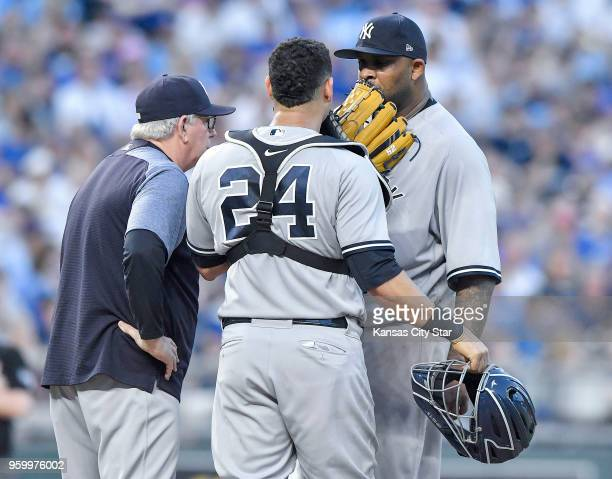 New York Yankees starting pitcher CC Sabathia receives a visit to the mound from catcher Gary Sanchez and pitching coach Larry Rothschild in the...