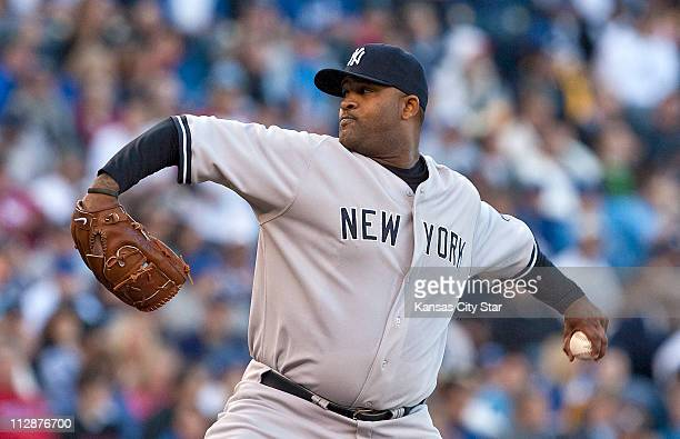 New York Yankees starting pitcher CC Sabathia throws in the first inning during a MLB baseball game against the Kansas City Royals at Kauffman...