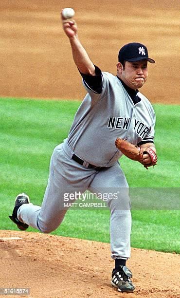 New York Yankees starting pitcher Hideki Irabu throws against the New York Mets in the first inning 11 July at Shea Stadium in Flushing New York The...