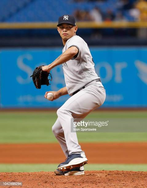 New York Yankees starting pitcher Jonathan Loaisiga delivers a pitch during the regular season MLB game between the New York Yankees and Tampa Bay...
