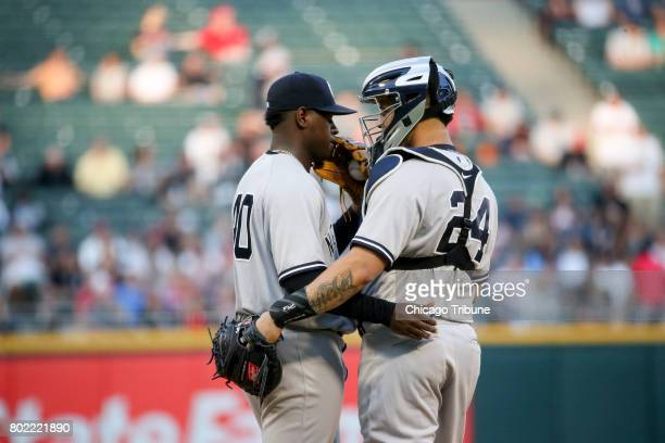 New York Yankees starting pitcher Luis Severino talks with catcher Gary Sanchez during the first inning against the Chicago White Sox at Guaranteed...