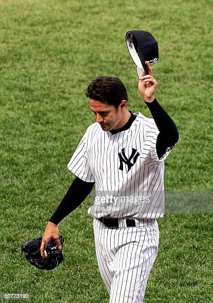 New York Yankees starting pitcher Mike Mussina tips his hat after pitching a complete game shutout against the Oakland Athletics on May 7, 2005 at...