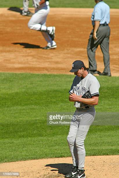 New York Yankees' starting pitcher, Randy Johnson hangs his head as Paul Konerko circles the bases after hitting the 3rd homer in a row during a game...