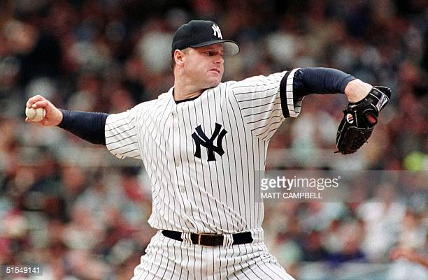 New York Yankees starting pitcher Roger Clemens throws against the Boston Red Sox in the top of the first inning 14 June 2000 at Yankee Stadium in...
