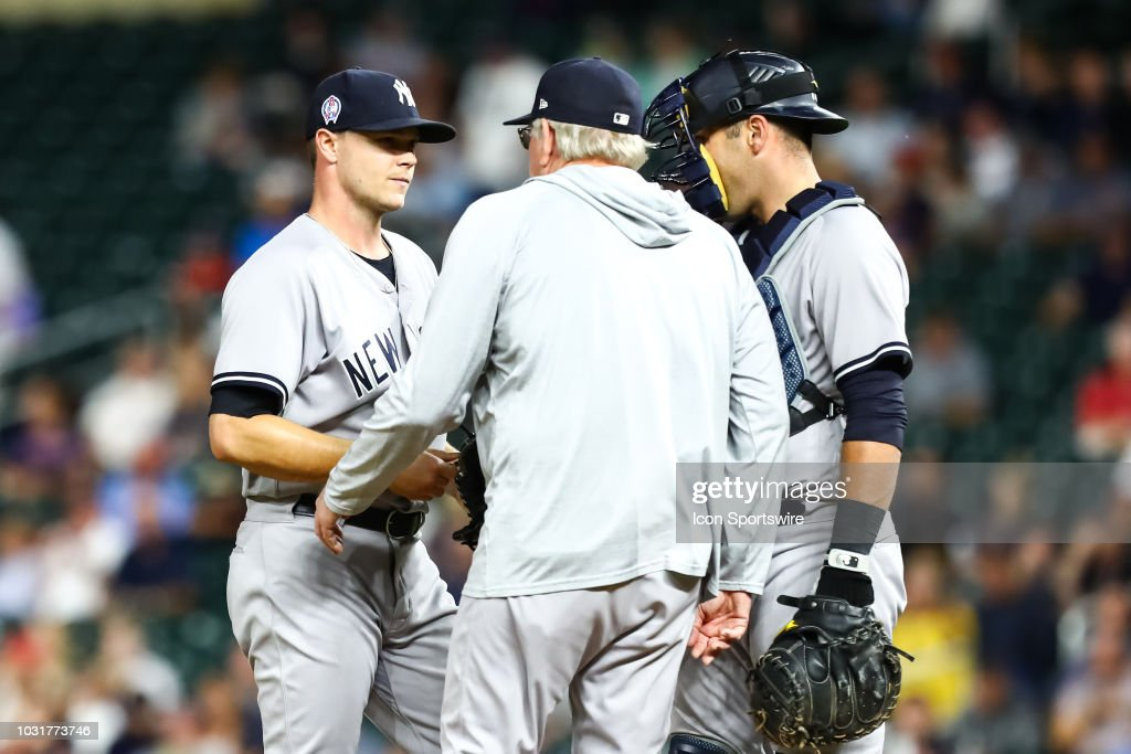 New York Yankees starting pitcher Sonny Gray (55) is visited on the mound by pitching coach Larry Rothschild (58) during the regular season game between the New York Yankees and the Minnesota Twins in September 11, 2018 at Target Field in Minneapolis, Minnesota. The Twins defeated the Yankees 10-5.