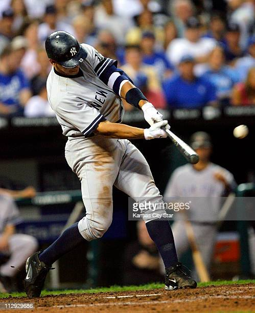 New York Yankees third baseman Alex Rodriguez connects on a solo home run for his 51st home run of the season in the sixth inning against the Kansas...