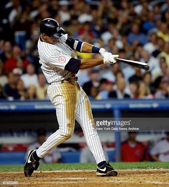 New York Yankees' third baseman Alex Rodriguez slugs a solo homer to right field to tie the game 33 in the third inning against the Boston Red Sox at...