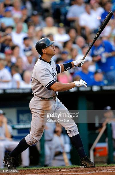 New York Yankees third baseman Alex Rodriguez watches a tworun home run his 50th home run of the season leave the field in the fourth inning against...