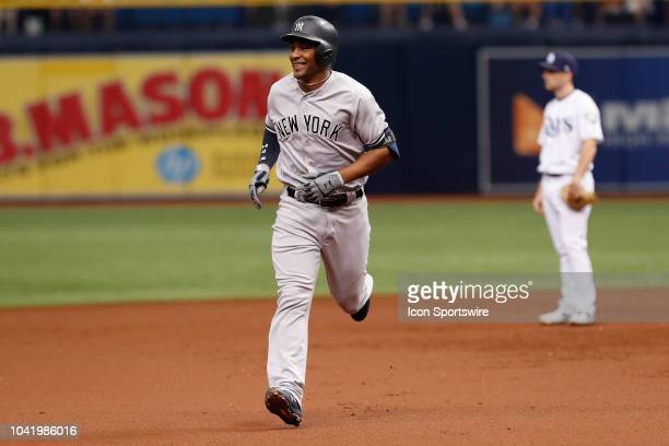 New York Yankees third baseman Miguel Andujar smiles as he rounds the bases after hitting a 3run homer in the 1st inning of the regular season MLB...