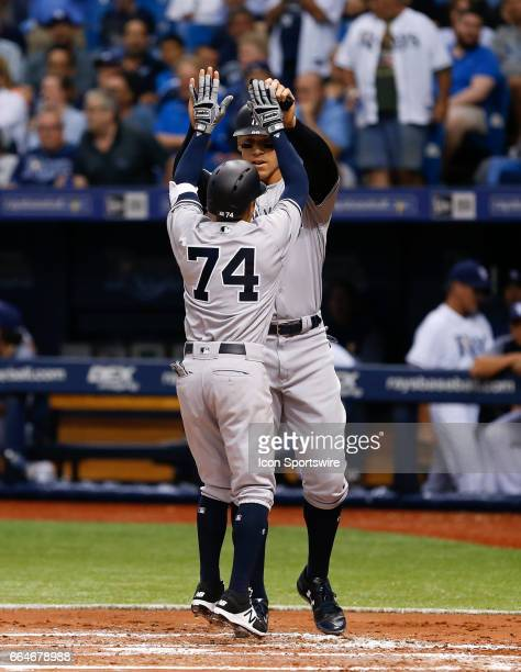 New York Yankees third baseman Ronald Torreyes is congratulated at home plate by New York Yankees right fielder Aaron Judge after hitting a 2run...