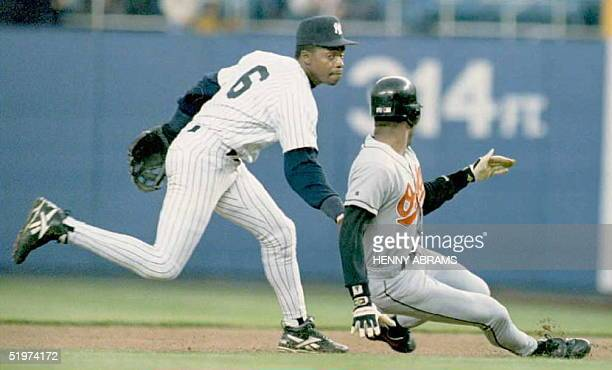 New York Yankees' Tony Fernandez tags the Baltimore Orioles' Kevin Bass out after he was caught in a rundown in the first inning 19 May in New York...
