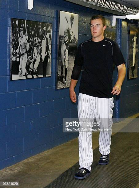 New York Yankees' top pitching prospect Phil Hughes walks inside Yankee Stadium after being called up to the majors to bolster the team's...