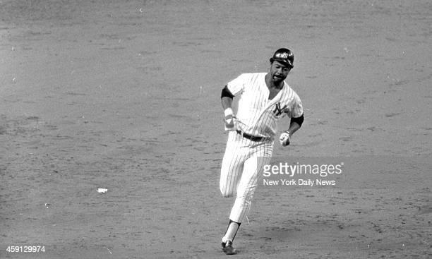 New York Yankees vs Kansas City Royals Cliff Johnson lumbers around third base after hitting homer to tie game