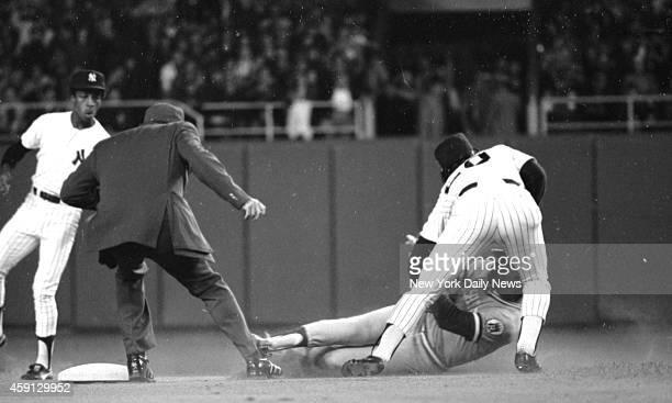New York Yankees vs Kansas City Royals Ha McRae slides under Thurman Munson peg to Bucky Dent in first