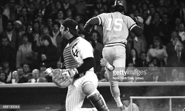 New York Yankees vs Kansas City Royals Yank Thurman Munson is left holding the bag and ball as Darrell Porter scores in third inning