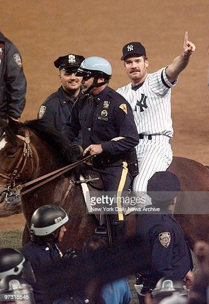 New York Yankees' Wade Boggs celebrates on police horse after Yankees defeated the Atlanta Braves in World Series