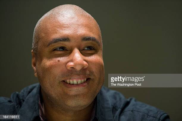 New York Yankeeturnedjazz guitarist Bernie Williams pauses during an interview at the Kennedy Center for Performing Arts on March 19 2013 in...